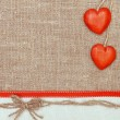Valentine card with red hearts and ribbon — Stock Photo