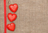 Wooden hearts on the burlap — Foto Stock