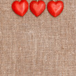 Stock Photo: Wooden red hearts on hessian