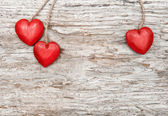 Wooden hearts on old wood — Stock Photo