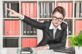 Angry woman boss pointing out — Stock Photo