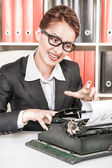Crazy business woman working with typewriter — Stock Photo
