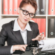 Mature business woman working with typewriter — Stock Photo