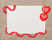 Valentine card with ribbon and hearts — Stock Photo