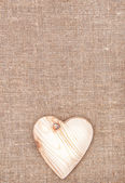 Wooden heart on the burlap — Foto Stock