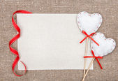 Valentine card with textile hearts — Stock Photo