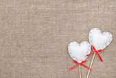 Textile hearts on the burlap — Stock fotografie