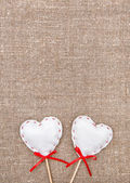 Textile hearts on the burlap — Stok fotoğraf