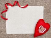Valentine card with textile heart and ribbon — Stock Photo