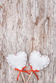 Valentine background with textile hearts on old wood — Stock Photo