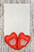 Valentine card with textile hearts on old wood — Stock Photo