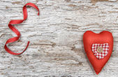 Valentine background with textile heart on old wood — Stock Photo