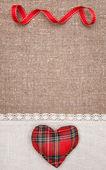 Textile heart and linen cloth on the burlap — Stock Photo
