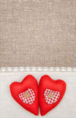 Textile hearts and linen cloth on the burlap — Stock Photo