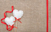 Valentine card with textile hearts and ribbon — Stock Photo