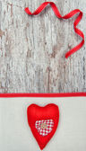Valentine card with textile heart on canvas — Stock Photo