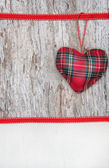 Valentine card with textile heart on canvas and old wood — Stock Photo