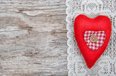 Valentine card with textile heart on lacy cloth and old wood — Fotografia Stock