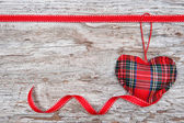 Valentine card with textile heart and ribbon on old wood — Foto de Stock