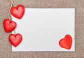 Valentine card with drawing heart and wooden hearts — Stock Photo