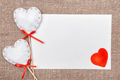 Valentine card with drawing red heart on burlap — Stock Photo