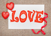 Valentine card with drawing word love and ribbon — Stock Photo