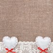 Stock Photo: Textile hearts and lacy cloth on burlap