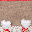 Stock Photo: Valentine card with textile hearts and lacy cloth