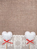 Textile hearts and lacy cloth on the burlap — Foto de Stock