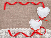 Valentine card with textile hearts and lacy cloth — Stock Photo