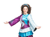 Young woman in irish dance dress welcoming — Stockfoto