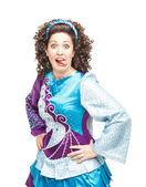 Woman in irish dance dress showing tongue — Stock Photo