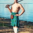 Scottish man with sword near the sea — Stock Photo #41494653