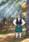 Handsome scottish man in the forest — Stok fotoğraf