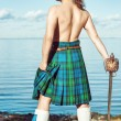 Scottish man with sword near the sea — Stock Photo #41543663