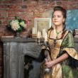 Stock Photo: Beautiful womin medieval dress with candelabrum