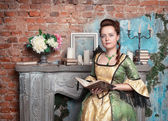 Beautiful woman in medieval dress with book — Stock Photo