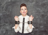 Business woman with handcuffs on her hands — Stock Photo