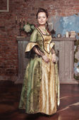 Beautiful woman in long medieval dress — Stock Photo