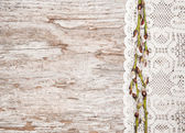 Easter decoration with catkins and lace cloth on old wood — Foto de Stock