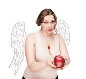 Beautiful plus size woman as angel suggest apple — Stock Photo