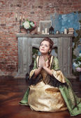 Praying beautiful woman in medieval dress — Stock Photo