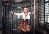 Screaming beautiful steampunk woman in the cage — Stockfoto