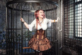 Screaming beautiful steampunk woman in the cage — Stock fotografie