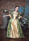 Smiling beautiful woman in medieval dress dance — Stock Photo