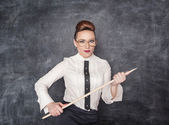 Strict teacher with wooden pointer — Fotografia Stock