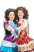 Happy Irish dancers showing thumbs up sign — Stock Photo