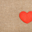Felt red heart on the burlap — Stock Photo #44829331