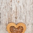 Wooden heart on the lace fabric and old wood — Stock Photo #47734257