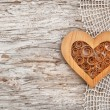 Wooden heart on the lace fabric and old wood — Stock Photo #47734255